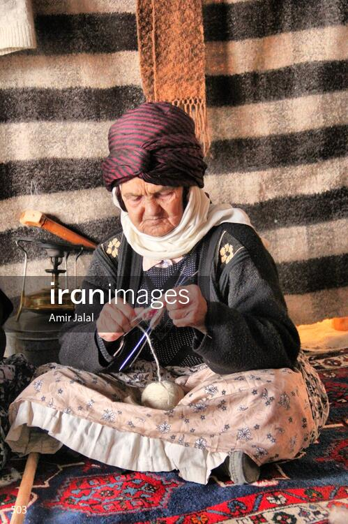 Nomad woman spinning wool