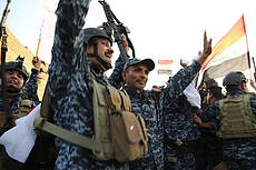 Iraqis Celebrate Victory Against ISIS In Mosul